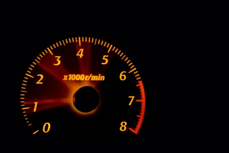 Car dashboard gauges illuminated at night, tachometer, speedometer Stock Photo