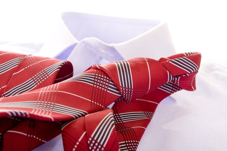 Blue shirt and red tie on white