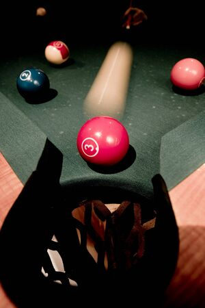 Vintage billard balls on green table photo