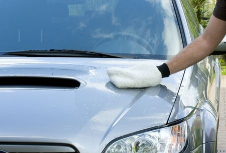 carwash: Cleaning the Car - washing process Stock Photo