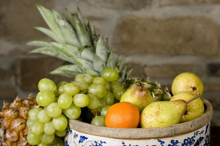 Traditional basket full of fruits - still life shoot Stock Photo - 5007408