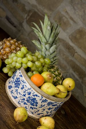 Traditional basket full of fruits - still life shoot Stock Photo - 5547183
