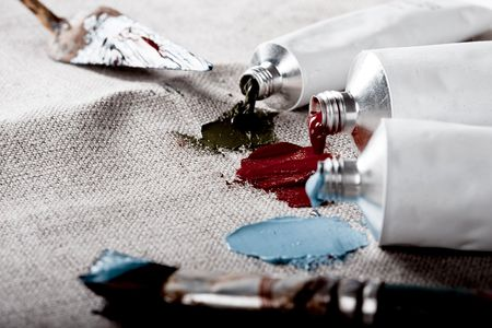 Paint tubes on linen canvas  Stock Photo - 5577502