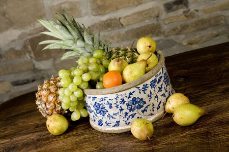 Traditional basket full of fruits - still life shoot Stock Photo - 5589781