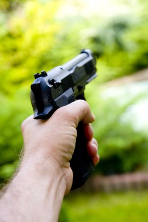 Man holds gun in his hand Stock Photo - 5589776