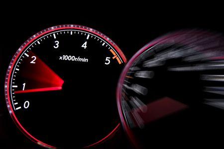 Car dashboard gauges illuminated at night, tachometer, speedometer Stock Photo - 5633144