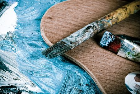 Painting brushes in artist studio