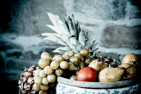 Traditional basket full of fruits - still life shoot Stock Photo - 6237200