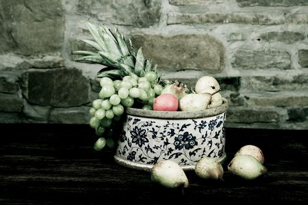 Traditional basket full of fruits - still life shoot Stock Photo - 6254611