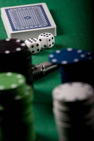 Casino gambling chips on green table Stock Photo - 6499787