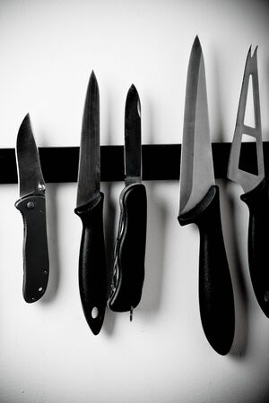 compared: Kitchen knifes and army knife compared Stock Photo
