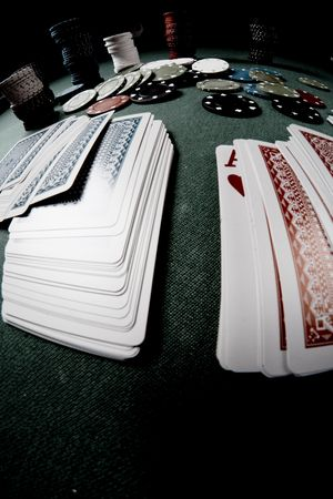 Casino gambling chips on green table Stock Photo - 6571792