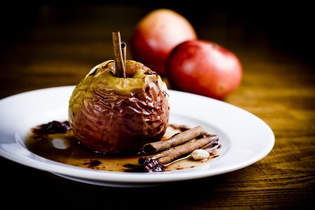 Hot baked apple with cinnam sticks Stock Photo