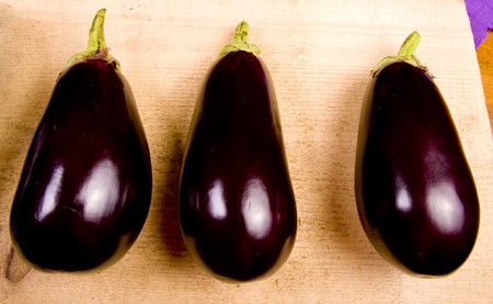 aubergine on raw wood in the kitchen Stock Photo - 7101046
