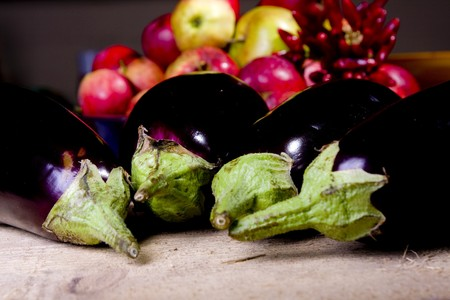aubergine on raw wood in the kitchen Stock Photo - 7101038