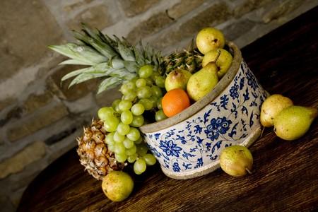 Traditional basket full of fruits - still life shoot Stock Photo - 7101050