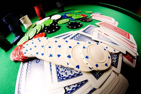Casino gambling chips on green table