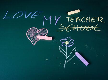 Love my teacher written on green chalkboard in school photo