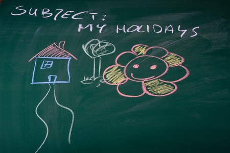 described: Holidays described on green chalkboard Stock Photo