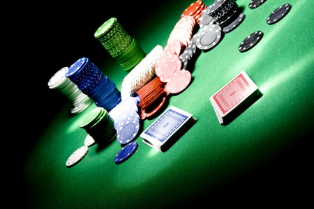 Casino gambling chips on green table Editorial