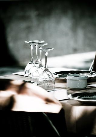 Dishware prepared for dinner in restaurant