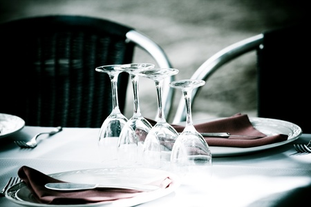 Dishware prepared for dinner in restaurant