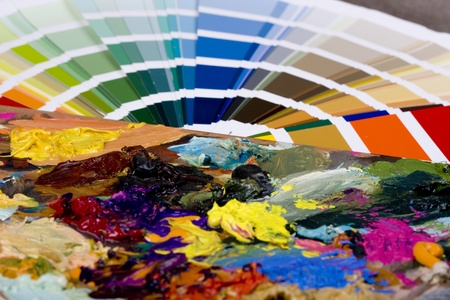 compared: Color sampler compared to artistic paint Stock Photo