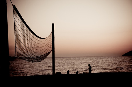 Volleyball net  on Croatian beach with sea in background photo