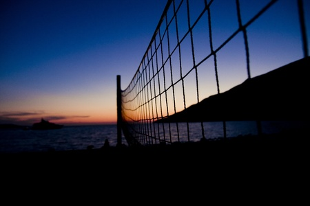 Volleyball net  on Croatian beach with sea in background