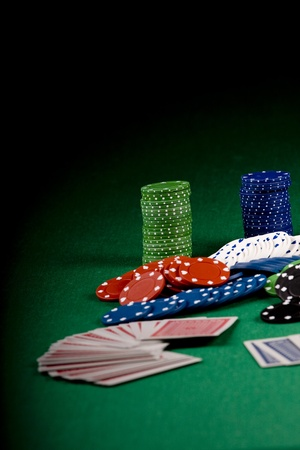 Casino gambling chips on green table photo