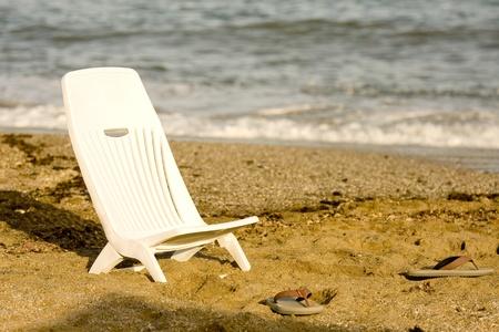 Beach sitting chair and flip flops