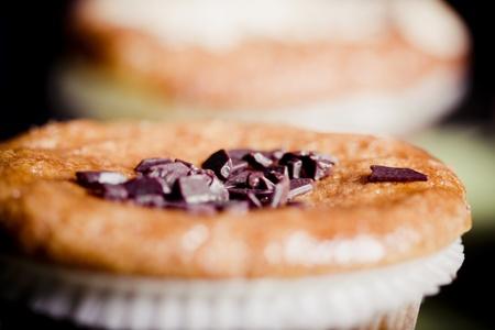 fresh chocolate chip muffins . Macro with shallow dof. Stock Photo