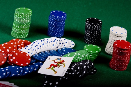 Casino gambling chips on green table Stock Photo - 10801096