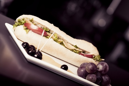 long baguette sandwich with cheese,  fresh vegetables and olives Stock Photo - 10801077