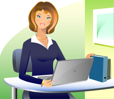 A beautiful business woman sitting and working at a computer, wearing a suit and smiling.