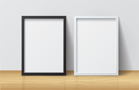 wood frame: Realistic White and Black Blank Picture frame, standing on Light Wood Floor at White Wall from the Front.  Design Template for Mock Up.