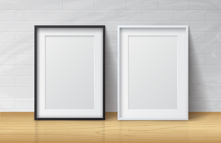 Realistic White and Black Blank Picture frame, standing on Light Wood Floor atWhite Brick Wall from the Front. Design Template for Mock Up.