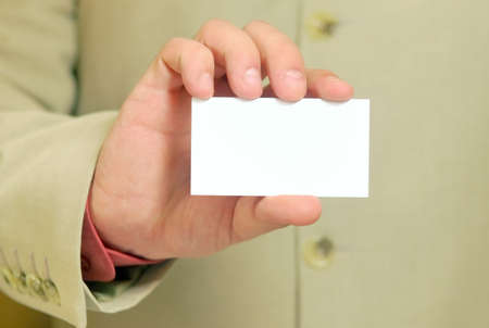 white business card in a hand photo