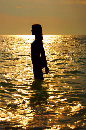 A woman early in the morning on the sea photo