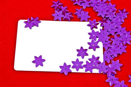 white card and violet stars on red background  photo