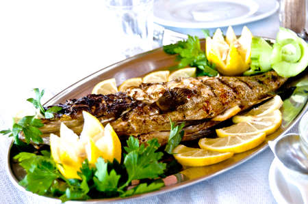 cooked fish: fried fish on a platter