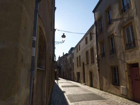 Small street exploration in Metz on a bright sunny day, discovering the old architecture