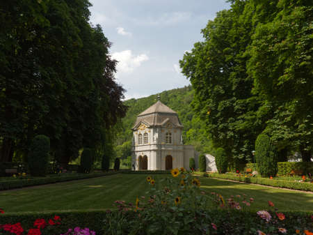 Alignment of the rokoko pavilion and the garden in the park in Echternach with a blue sky of summer