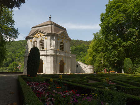 Perspective view of the garden and the rokoko pavilion in the park in Echternach with a blue sky of summer