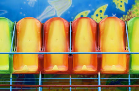 hilarity: Multi-coloured seats. An old mobile attraction