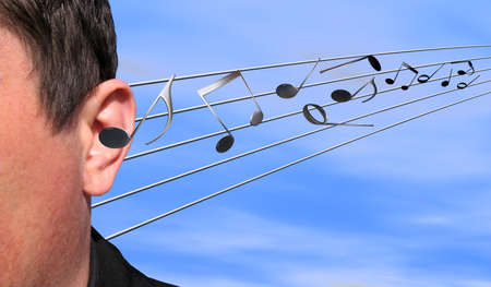 ballad: Musical notes flying in an ear Stock Photo