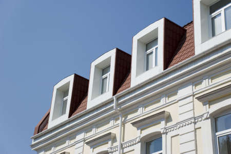 Facade of a building with attics. The ancient restored building Stock Photo - 1755002