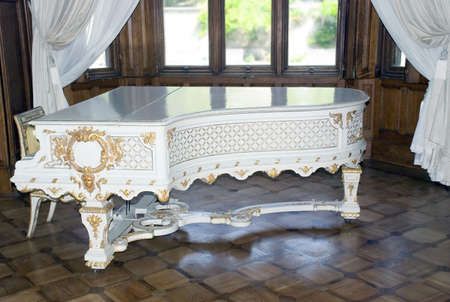 luxuriance: White ancient grand piano trimmed by gold (job of the Italian masters 1700-1800)  Stock Photo