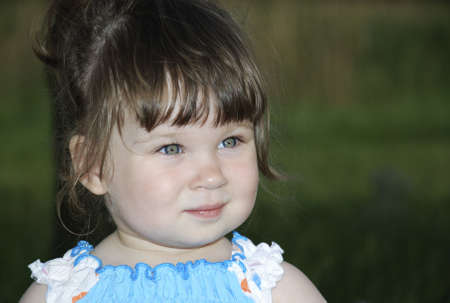 Portrait of the little girl in blue - a white sundress Stock Photo - 1755037
