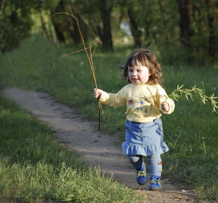The running girl on a footpath (age 2 years)  Stock Photo - 1755043